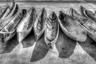 Canoes In Black And White Poster by Debra and Dave Vanderlaan
