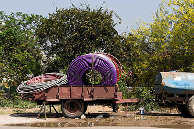 Cartoon - Coils Of Thick Plastic Pipe On A Carrier Wagon Poster by Ashish Agarwal