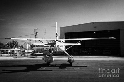 Cessna U206g Fixed Wing Single Engine Seaplane In Front Of Hangar Key West International Airport Flo Poster by Joe Fox