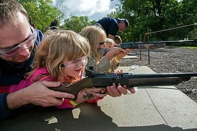 Children Shooting Bb Guns Poster by Jim West