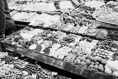 chocolates on display inside the la boqueria market in Barcelona Catalonia Spain Poster by Joe Fox
