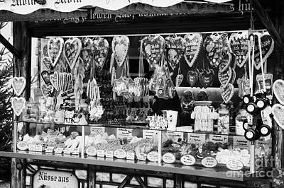 christmas market stall selling Lebkuchen and various sweets and nuts confectionery Berlin Germany Poster by Joe Fox