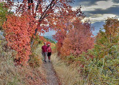 Couple On Trail Among Fall Foliage Poster by Howie Garber