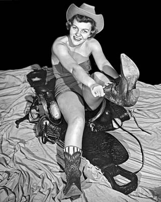 Cowgirl Pulls On Her Boots Poster by Underwood Archives