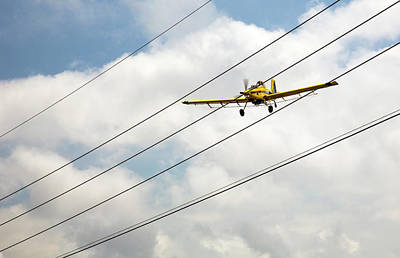 Crop Duster And Electricity Power Lines Poster by Jim West