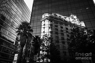 edificio ariztia building reflected in modern bank buildings in the financial district of Santiago Chile Poster by Joe Fox