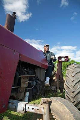 Farmer On A Tractor Poster by Jim West