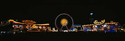 Ferris Wheel And Neon Signs Lit Poster by Panoramic Images