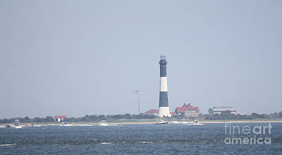 Fire Island Lighthouse With Boats Wading In Front Of It #1 Of 4 Poster by John Telfer