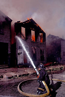 Firefighter During A Rescue Operation Poster by Panoramic Images
