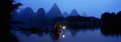 Fisherman Fishing At Night, Li River Poster by Panoramic Images