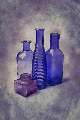 Four Glass Bottles Poster by Garry Gay