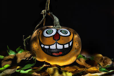 Funny Whimsical Halloween Pumpkin In A Bed Of Fall Leaves Poster by Wendy Thompson