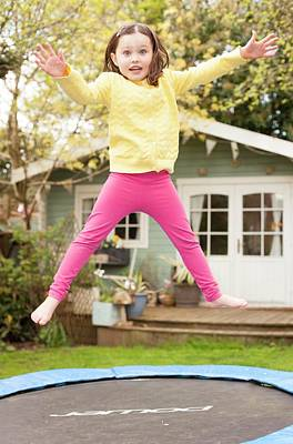 Girl Bouncing On A Trampoline Poster by Ian Hooton