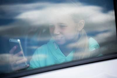 Girl Using Smartphone In Car Poster by Samuel Ashfield