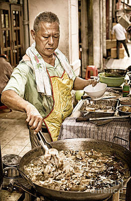 Golden Glow - South East Asian Street Vendor Cooking Food At His Stall Poster by David Hill