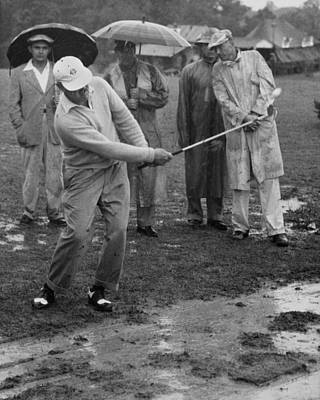 Golfer Playing In The Rain Poster by Underwood Archives