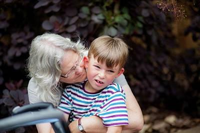 Grandmother Hugging Grandson Poster by Samuel Ashfield