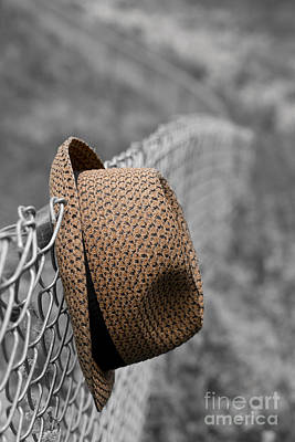 Hat On Chain Link Fence Poster by Edward Fielding
