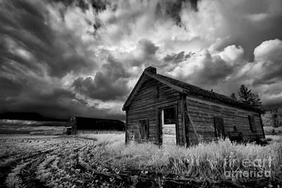 Homestead Under Stormy Sky Poster by Dan Jurak