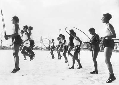 Hoop Jumping Schoolgirls Poster by Underwood Archives