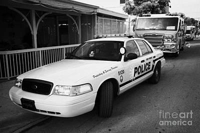 Key West Police Patrol Squad Car And Key West Fire Dept Engine Florida Usa Poster by Joe Fox