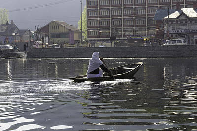 Light Following This Lady On A Wooden Boat On The Dal Lake In Srinagar Poster by Ashish Agarwal