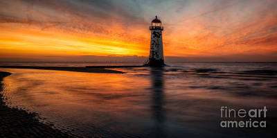 Lighthouse At Sunset Poster by Adrian Evans
