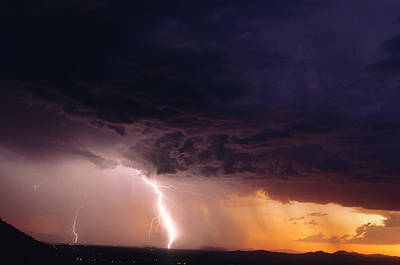Lightning In A Rain Curtain At Sunset Poster by Thomas Wiewandt