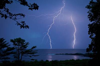 Lightning Over Sea Poster by Peter Menzel