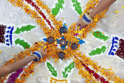 Making Rangoli With Flower Petals And Oil Lamps Poster by Tim Gainey