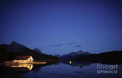 Maligne Lake Boathouse At Night Poster by Dan Jurak