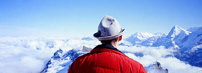 Man Contemplating Swiss Alps Poster by Panoramic Images