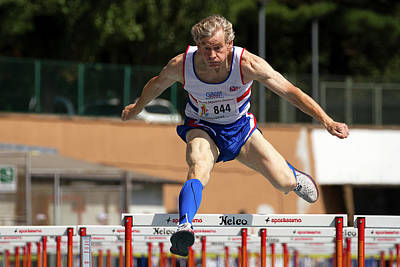 Masters British Athlete Clearing Hurdle Poster by Alex Rotas
