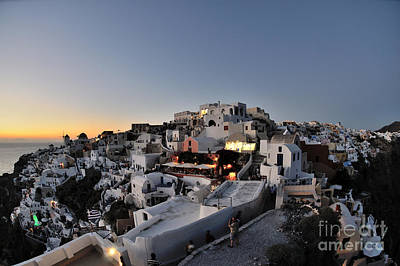 Oia Town During Dusk Time Poster by George Atsametakis