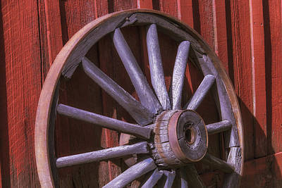 Old Wagon Wheel Leaning Against Barn Poster by Garry Gay