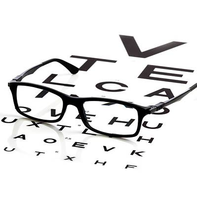 Opticians Chart And A Pair Of Glasses Poster by Science Photo Library