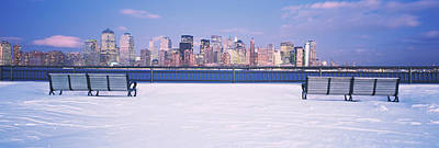 Park Benches In Snow With A City Poster by Panoramic Images
