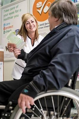 Patient Handing In Prescription Poster by Jim Varney