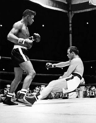 Patterson Knocks Out Johansson Poster by Underwood Archives