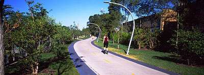 Rear View Of Woman Jogging In A Park Poster by Panoramic Images