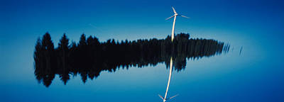 Reflection Of A Wind Turbine And Trees Poster by Panoramic Images
