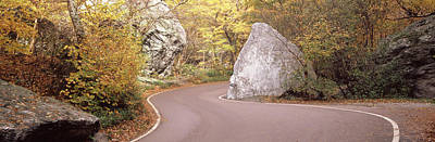 Road Curving Around A Big Boulder Poster by Panoramic Images