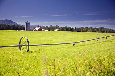 Rolling Irrigation Sprinkler On Hay Poster by Jeff Schultz