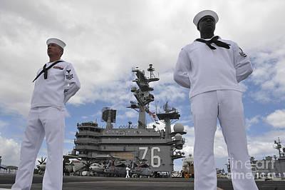 Sailors Man The Rails Aboard Uss Ronald Poster by Stocktrek Images