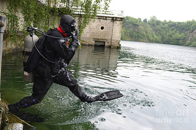 Senior Airman Enters The Water Poster by Stocktrek Images