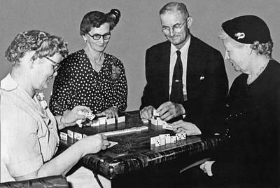 Seniors Playing Dominos Poster by Underwood Archives