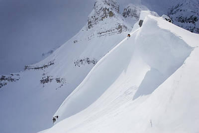 Skier On Crest Of Big Drop, Dwarfed By Poster by Ewan Nicholson Photography