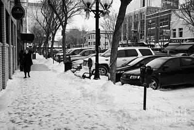 snow covered sidewalk in downtown Saskatoon Saskatchewan Canada Poster by Joe Fox