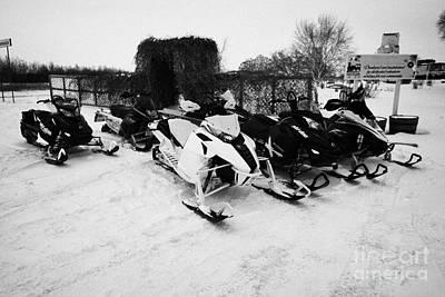snowmobiles parked in Kamsack Saskatchewan Canada Poster by Joe Fox